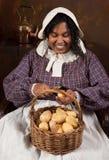 Victorian potato peeling Royalty Free Stock Images
