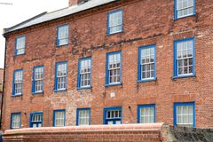 Victorian property with sash window frames painted blue. Large victorian property with sash window frames painted blue Stock Photo