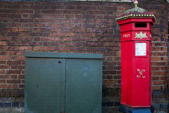 Victorian red British postbox on urban street Royalty Free Stock Image