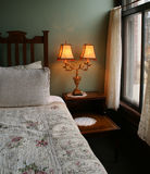Victorian Room. A victorian bed and lamp in Port Townsend, Washington stock photography