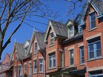 Victorian row houses with gables Stock Photos