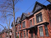Victorian row houses with gables Stock Photo