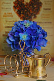 Victorian Silver Toast Holder and Milk Jug. With Blue Flowers Background Stock Photo