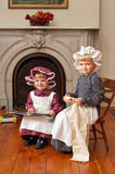 Victorian Sisters. Two little girls dressed in Victorian costume royalty free stock photo