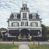 Victorian style funeral home ornate with unique crow`s nest i