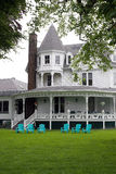 Victorian Style Home. An old white Victorian style home with classic architecture Royalty Free Stock Photography