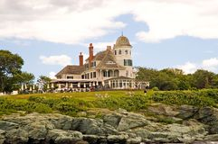 Victorian summer house. A view of a classic Victorian summer house on the rocky shore of Narragansett Bay, Newport, Rhode Island.  The building is now used as an Royalty Free Stock Photo