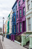 Victorian terraced houses colourfully painted. Coloured properties on Lancaster Road in Notting Hill neighbourhood, north west London Stock Photos