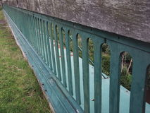 Victorian viaduct railings. Grey-green painted railings disapear to the horizon Royalty Free Stock Photography