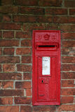 Victorian wall postbox. Wall Post box from the Victorian (mid 1800's) era, in an English village on a brick wall Royalty Free Stock Photography