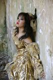 Victorian Woman. Chinese woman wearing victorian costume shoot at grunge building stock images