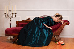 Victorian woman crying on couch Stock Photography