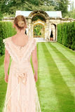 Victorian woman in formal garden Royalty Free Stock Image