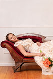 Victorian woman laying on couch Royalty Free Stock Image