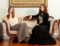 Victorian women couch sit Royalty Free Stock Photo