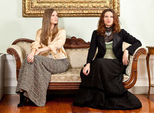 Victorian women couch sit Royalty Free Stock Images