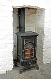 Victorian wood burning stove. Photo of a old black iron victorian wood burning stove in situ Royalty Free Stock Images
