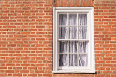 Victorian wooden frame white sash window with glass panels Royalty Free Stock Images