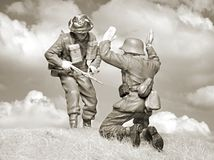 Victorious British soldier and fallen Nazi. WW II Scene - Victorious British soldier and fallen Nazi - Monochrome photography wooden figure Stock Image