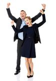 Victorious business couple with hands up Royalty Free Stock Images