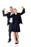 Victorious business couple with hands up Stock Photography