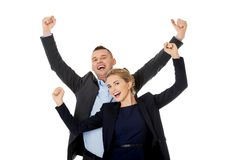 Victorious business couple with hands up Royalty Free Stock Photo