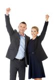 Victorious business couple with hands up Royalty Free Stock Photography