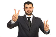 Victorious business man. Showing victory hands  gesture isolated on white background Stock Photos