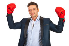 Victorious business man. Showing hands in boxing gloves isolated on white background Stock Photo