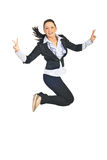 Victorious business woman jumping. Victorious busienss woman jumping and showing victory sign hand gesture over white background Stock Photo