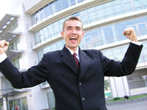 Victorious Businessman. Outdoors Royalty Free Stock Photography