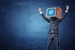 A victorious businessman with arms raised up and a retro TV showing a glowing bulb on his head. stock image