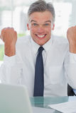 Victorious businessman cheering at camera Royalty Free Stock Photos