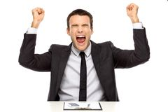 Victorious businessman holding fists up Stock Images