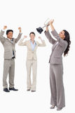 Victorious businesswoman with cup. Against a white background Royalty Free Stock Photo