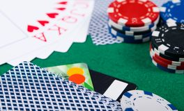 Victorious layout of cards, on a green background, with poker chips and bank cards Stock Images