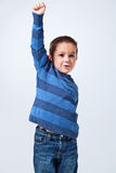 Victorious Little Boy. On a Light Grey Background Royalty Free Stock Photo