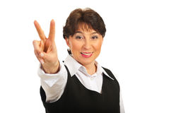 Victorious mature business woman stock photography