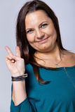 Victorious Mature Woman Showing Victory Sign Stock Photography