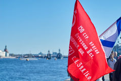 Victorious Russian flag and the St. Andrew's flag on embankment the Neva river Stock Photo