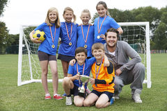 Victorious School Soccer Team With Medals And Trophy Stock Image