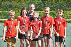 Victorious School Tennis Team With Medals. Portrait Of Victorious School Tennis Team With Medals Royalty Free Stock Photos