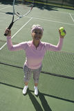 Victorious Senior Female Tennis Player Royalty Free Stock Photography