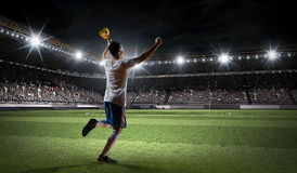 Victorious soccer player . Mixed media Stock Photo