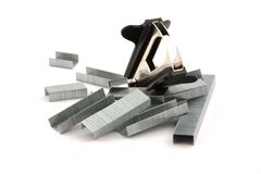 Victorious staple remover. On top of staples royalty free stock photos