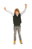 Victorious teen boy. With arms raised isolated on white background Stock Photography