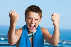 Victorious teen swimmer. Portrait of teen swimmer with victorious face reaction Stock Photo