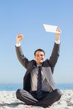 Victorious young businessman holding up his tablet computer Royalty Free Stock Images