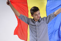 Victorious young man. Happy young man showing romanian national flag Royalty Free Stock Photos