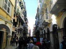 Tourists on narrow street Stock Photos